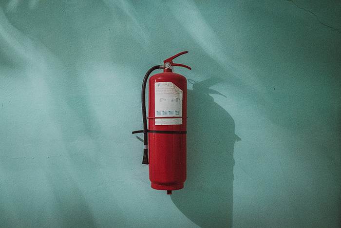 A fire hydrant attached to a green wall - fire photography tips
