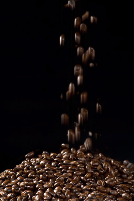 Flash photography shot of Falling Coffeee Beans against a black background