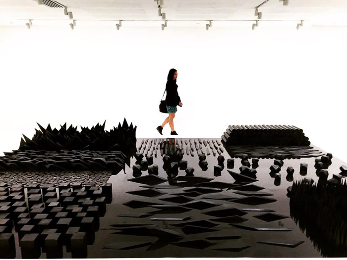 A photo of a girl looking at an art installation shot using iPhone camera