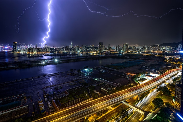 Forked lighting striking over a city at night
