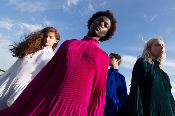 Low angle photography of four women demonstrating how to model pose for fashion shots