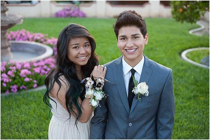 Cute prom pictures of a teen couple posing outdoors