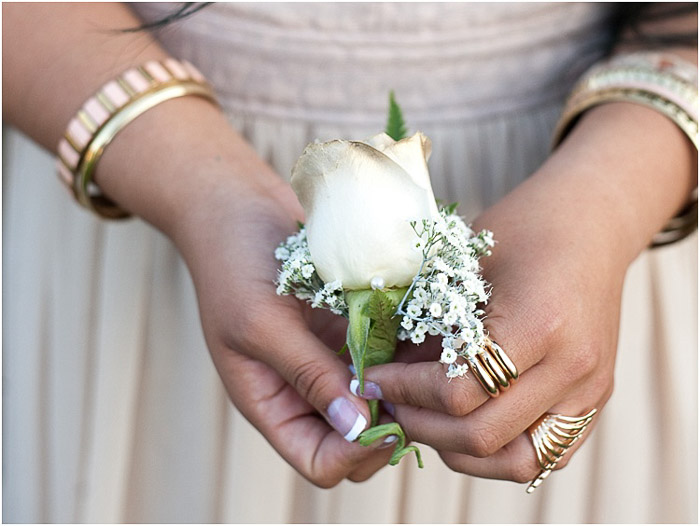 prom picture poses- close up of a teen girl holding a corsage flower