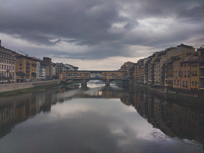 Reflection of a cityscape in a river in Florence, Italy