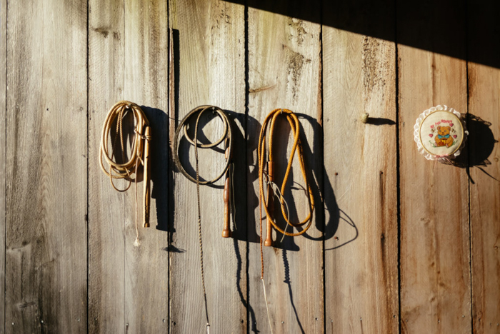 ropes hanging on nails on a wood wall - photo editing tips for smartphone photography