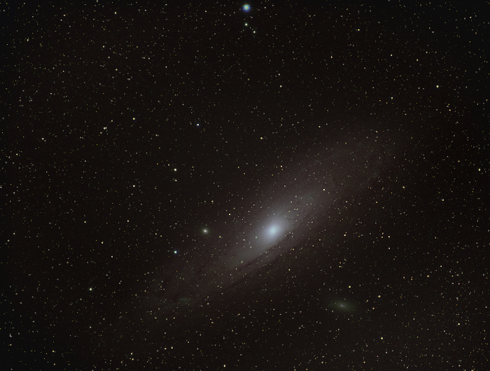 Andromeda in the night sky, flipped horizontally and vertically.
