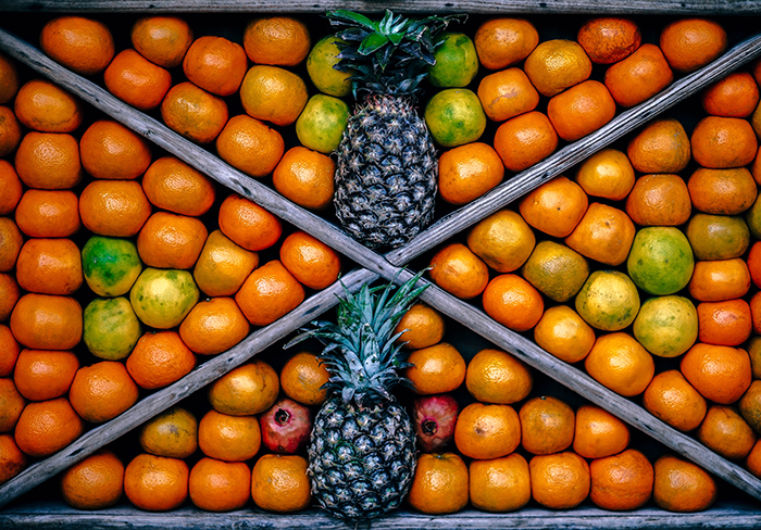 an exciting still life composition featuring fruit, shot with the help of symmetry in photography