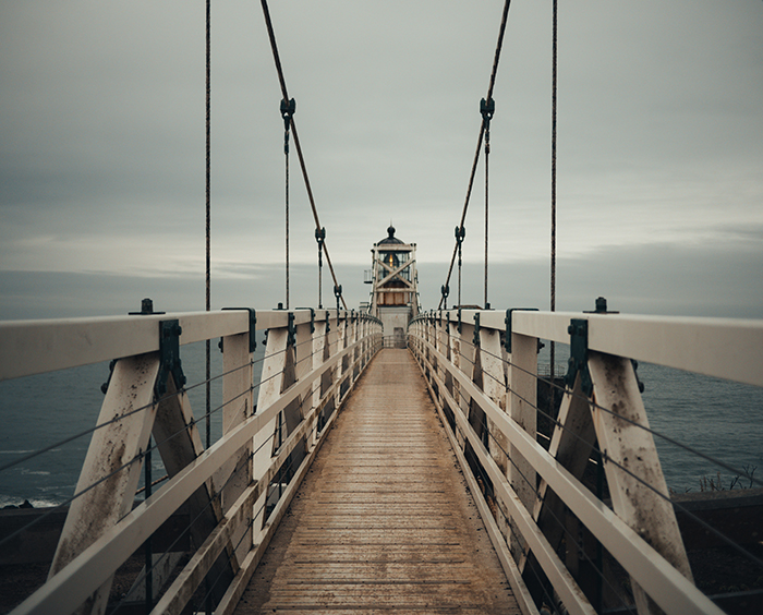 A photo of a wooden pier using symmetry in photography composition