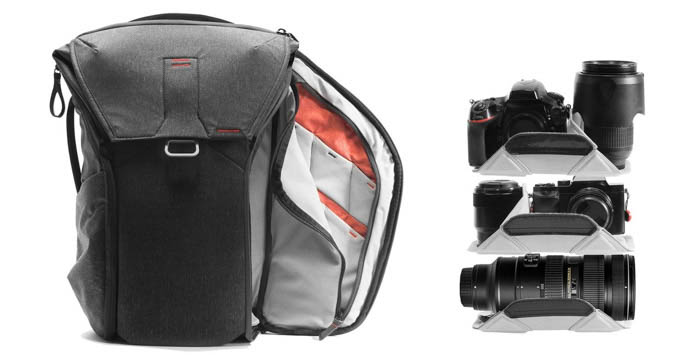 front view of Peak Design backpack camera travel bag, side zipper open and showing padding for camera lenses