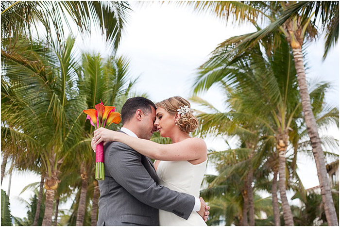 A romantic destination wedding photography shot of the couple embracing outdoors