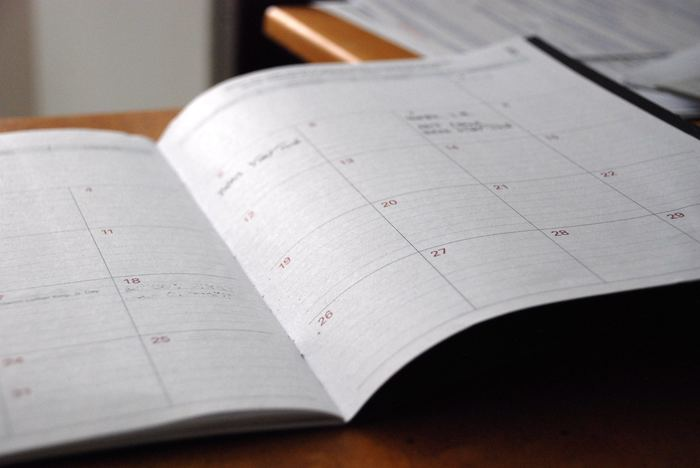 Photo of an open planner with the calendar