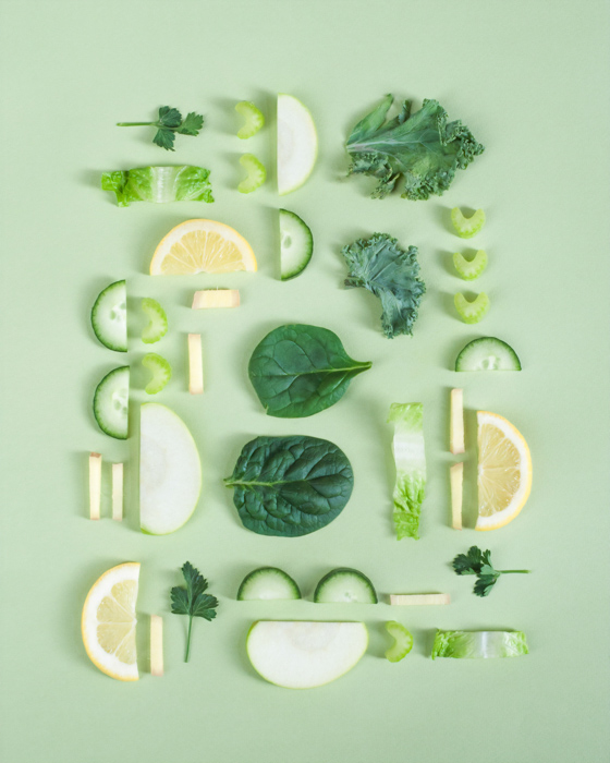 A food photography flat lay with emphasis on a monochromatic color palette, based on shades of green with splashes of analogous yellow