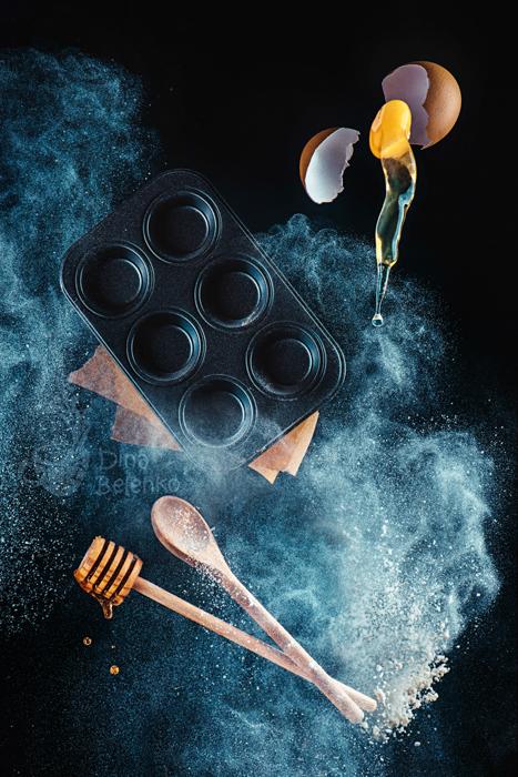 A magical still life shot using kitchen utensils and flour clouds