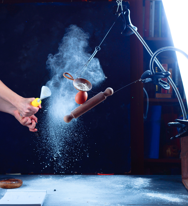 Setup of shooting a still life using flying kitchen utensils and flour clouds - creative still life photos