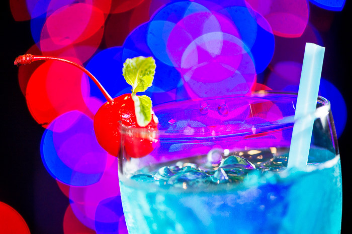 A blue cocktail with blurry bokeh light background