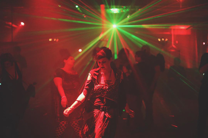 Atmospheric nightclub photography portrait of a female dancer
