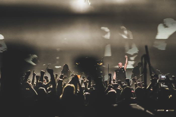 A live concert performance in a dark indoor setting - nightclub photography tips