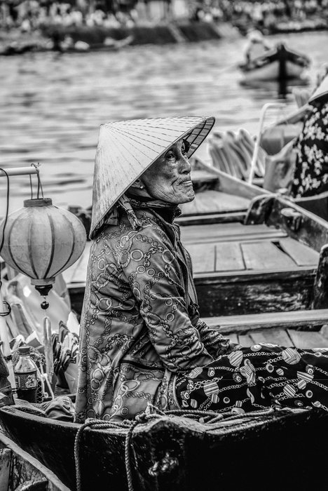 A black and white portrait of an old woman in traditional dress - street photography quotes