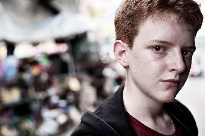 A portrait of a young man shot with Nikon prime lenses