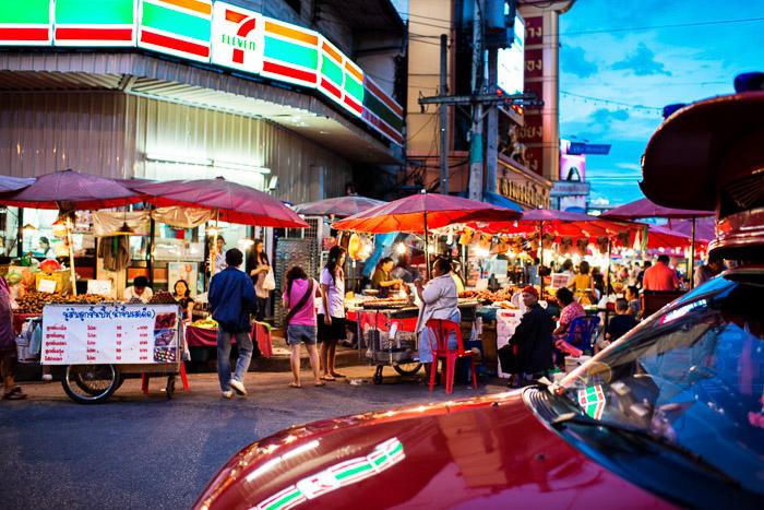 A busy street scene shot with a Nikon prime lens