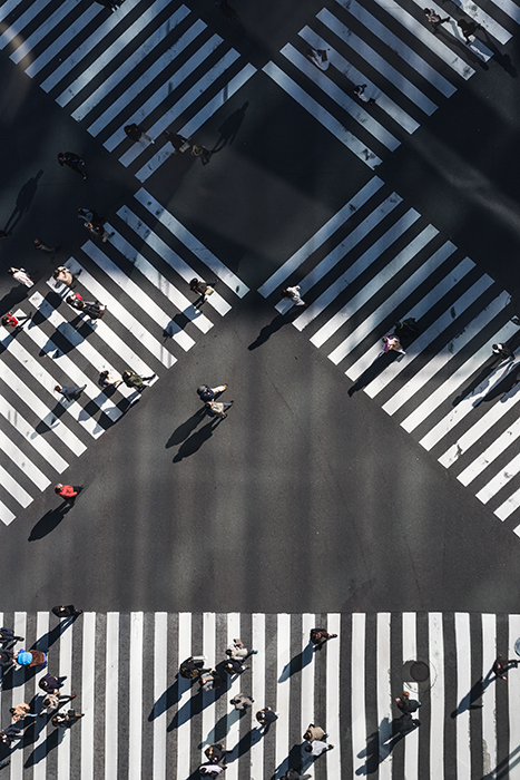 An overhead shot at people walking at a pedestrian crossing