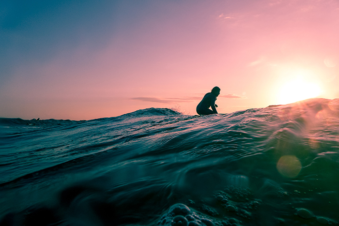 Atmospheric evening shot of a surfer