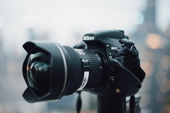 A Nikon DSLR set up on a tripod