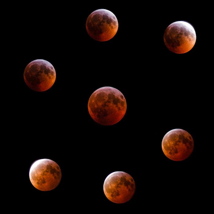 Composto do eclipse lunar em torno da totalidade.