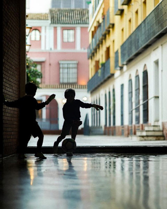 hildren playing in a pretty street scene - contemporary street photographer Steven John Irby
