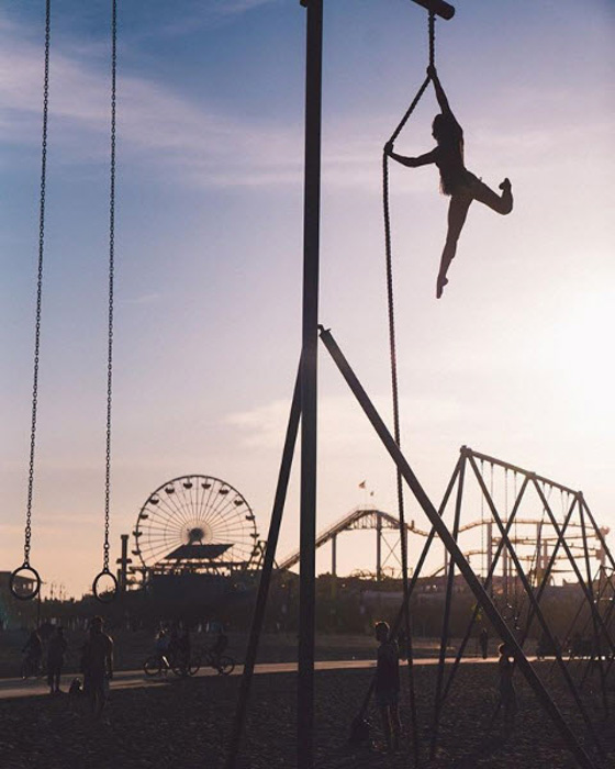 The silhouette of an acrobat at a funfair by JN Silva