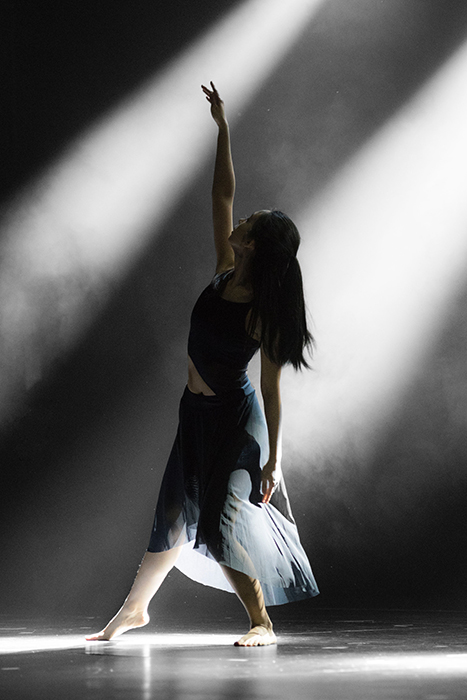 Atmospheric dance photography shot of a female dancer mid performance