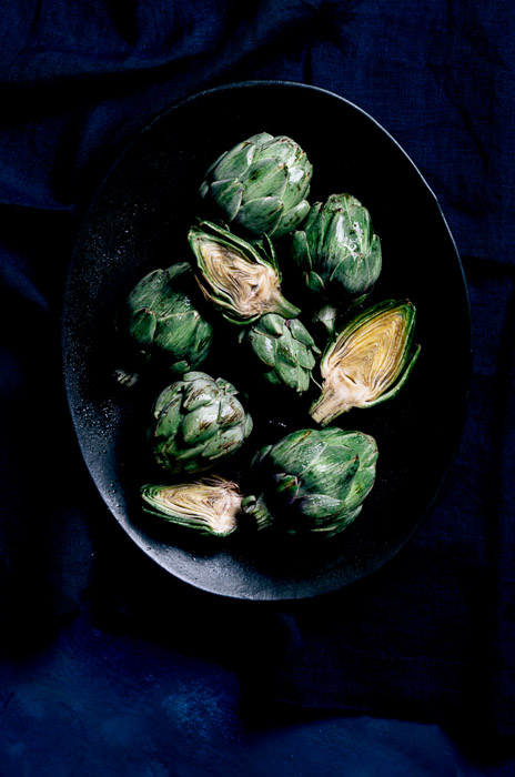 Overhead shot of brussel sprouts in a bowl shot on diy food photography backgrounds