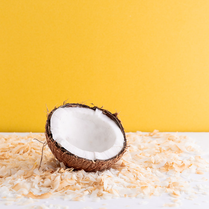A coconut shot on diy food photography backgrounds made using contact paper on yellow background