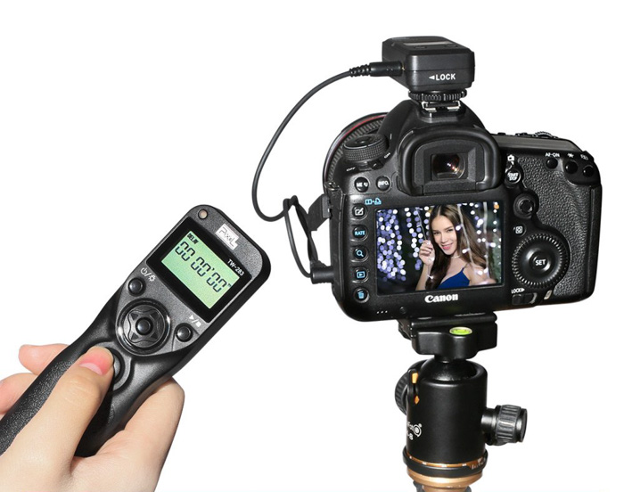 A remote trigger beside a DSLR camera - photo booth ideas