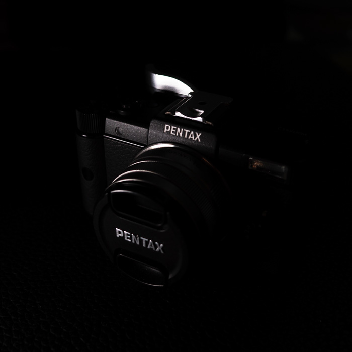 A Pentax camera on a black background - how to make a photo booth