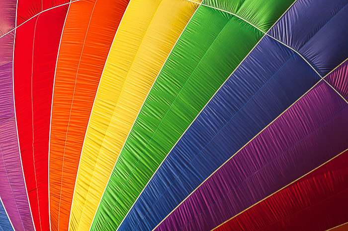 A close up photo of a colorful hot air balloon