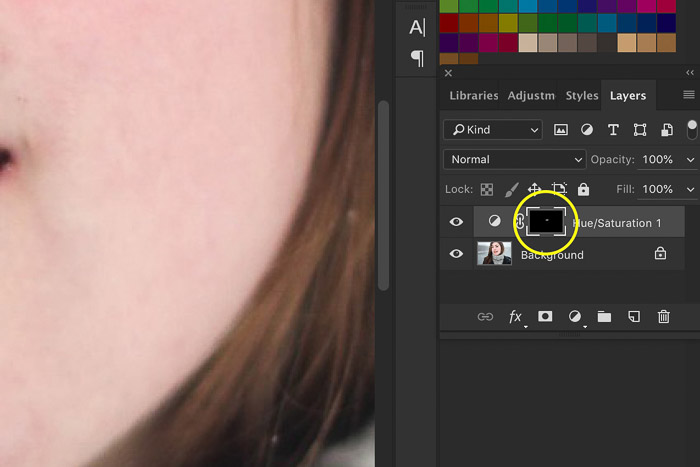A screenshot showing how to whiten teeth in Photoshop using a layers mask