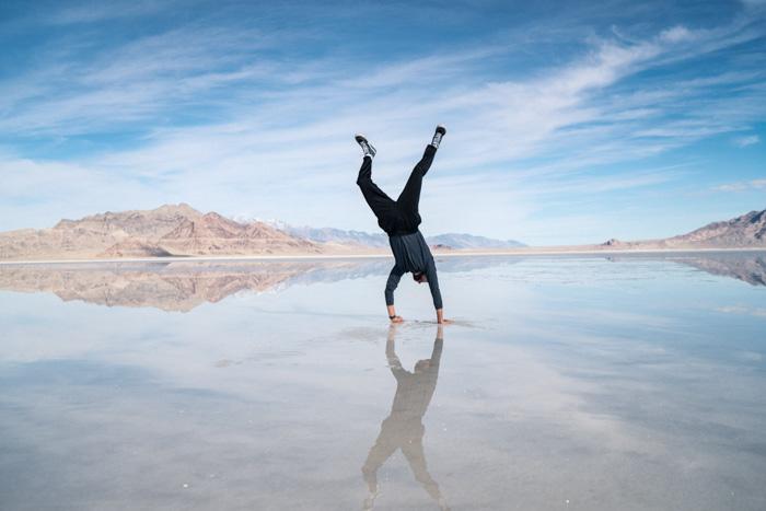 A man doing a handstand in the salt flats Salar de Uyuni in Bolivia