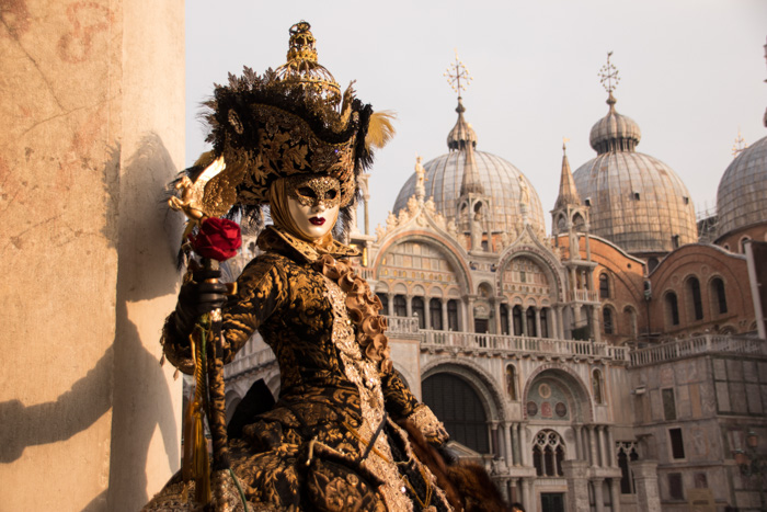 A person in carnival costume - most iconic places in the world to photograph