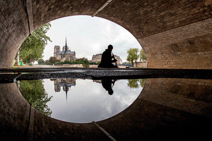An interesting viewpoint of the Notre Dame from under a bridge.