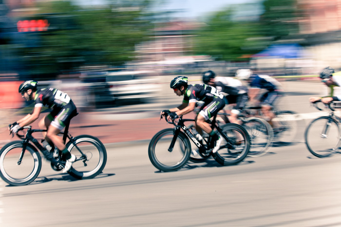 A high speed sports photography shot of a cycling race