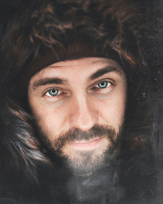 Atmospheric portrait of a bearded man wearing a furry hood and hat - photo assignment tips