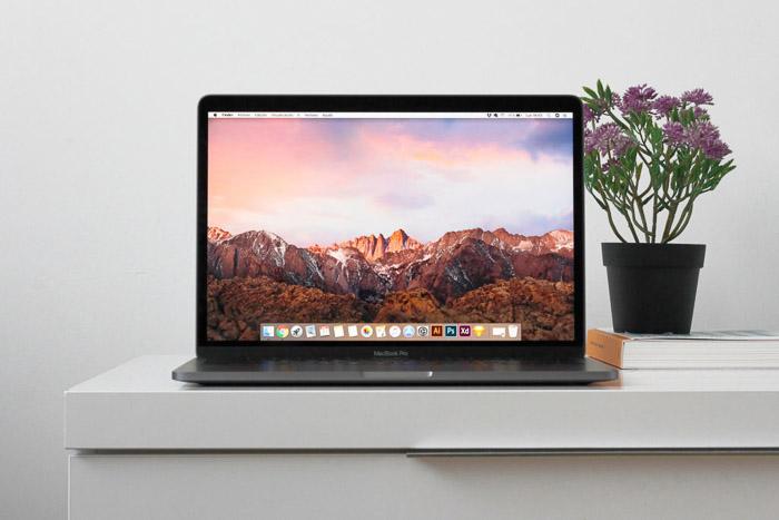A laptop open on a white desk