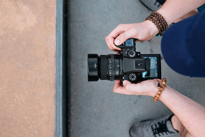 A photographer holding a Dslr camera