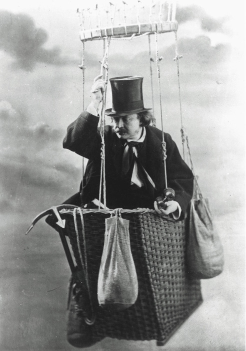 An old black and white portrait of a man in a hot air balloon