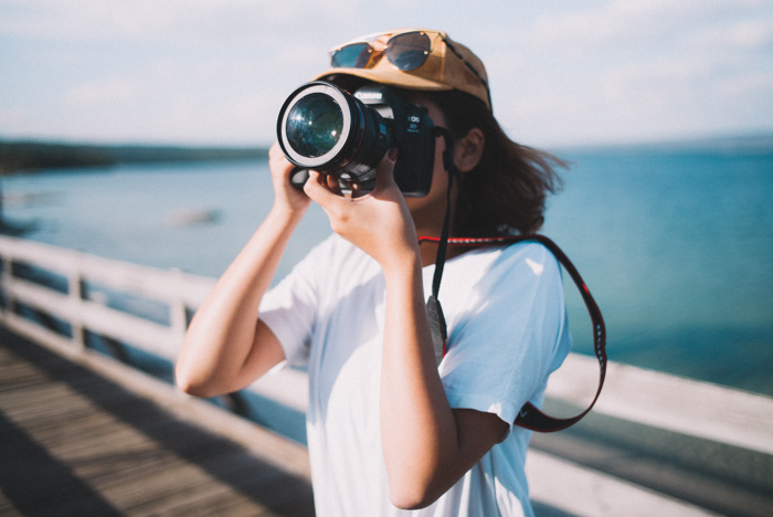 A portrait of a female photographer outdoors - photo challenge ideas