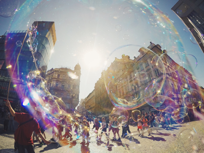 Atmospheric outdoor photo shot through a street artists bubbles - 365 photo challenge ideas