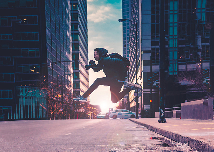 A street photographer jumping over an urban road - photo series project