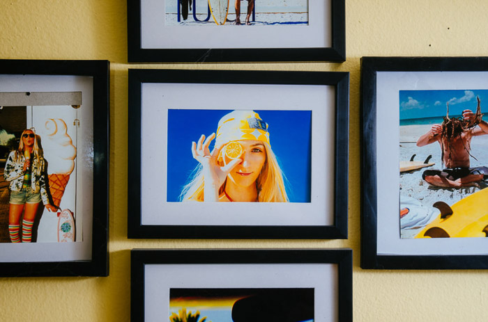 A selkection of framed iphone prints on a wall