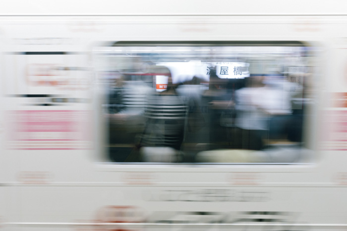 A blurry photo of passengers on a train - shutter priority mode